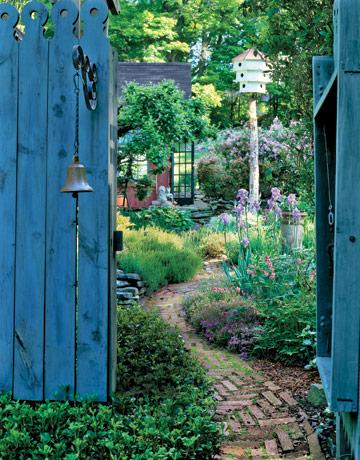 behind the blue gate birdhouse